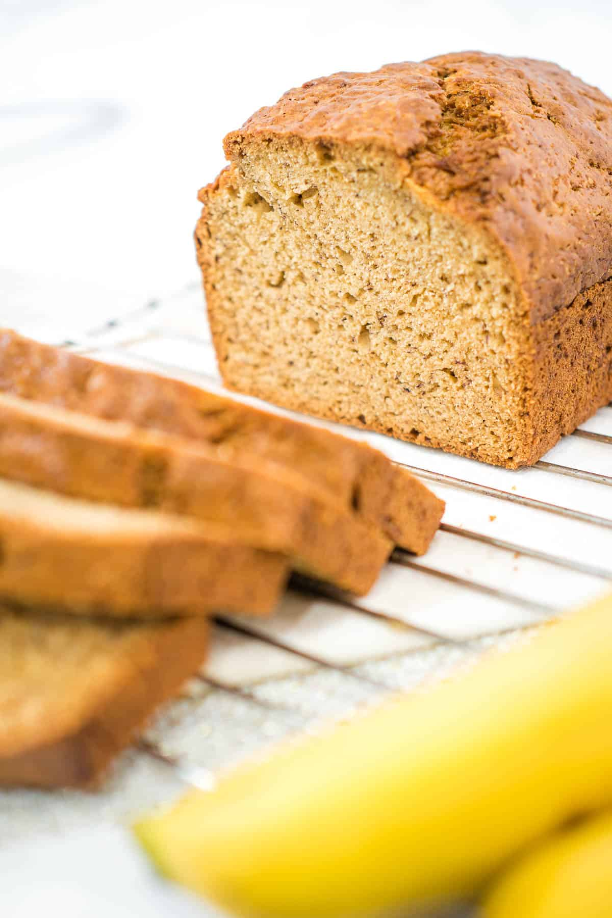 Banana bread with some cut into slices
