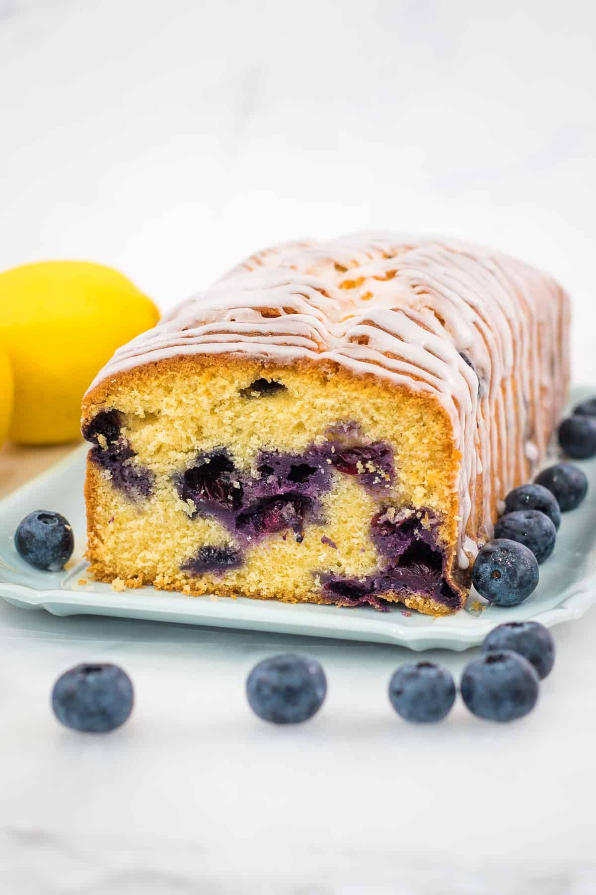 The front view of a blueberry cake loaf that can be sliced.
