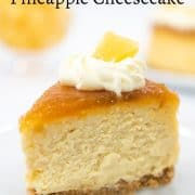 A slice of cheesecake with pineapple topping and whipped cream
