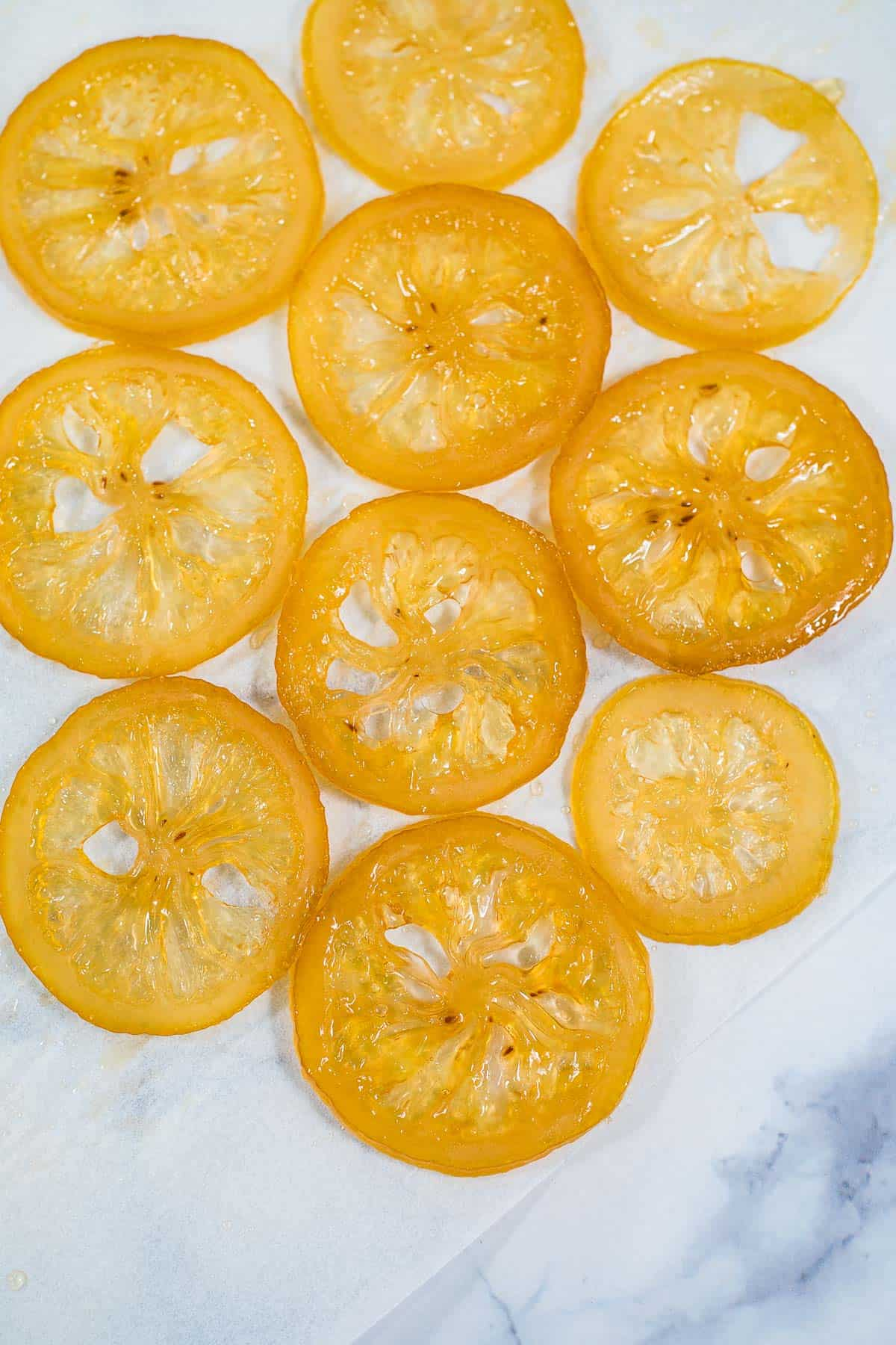 Close up of candied lemon slices against a marble background