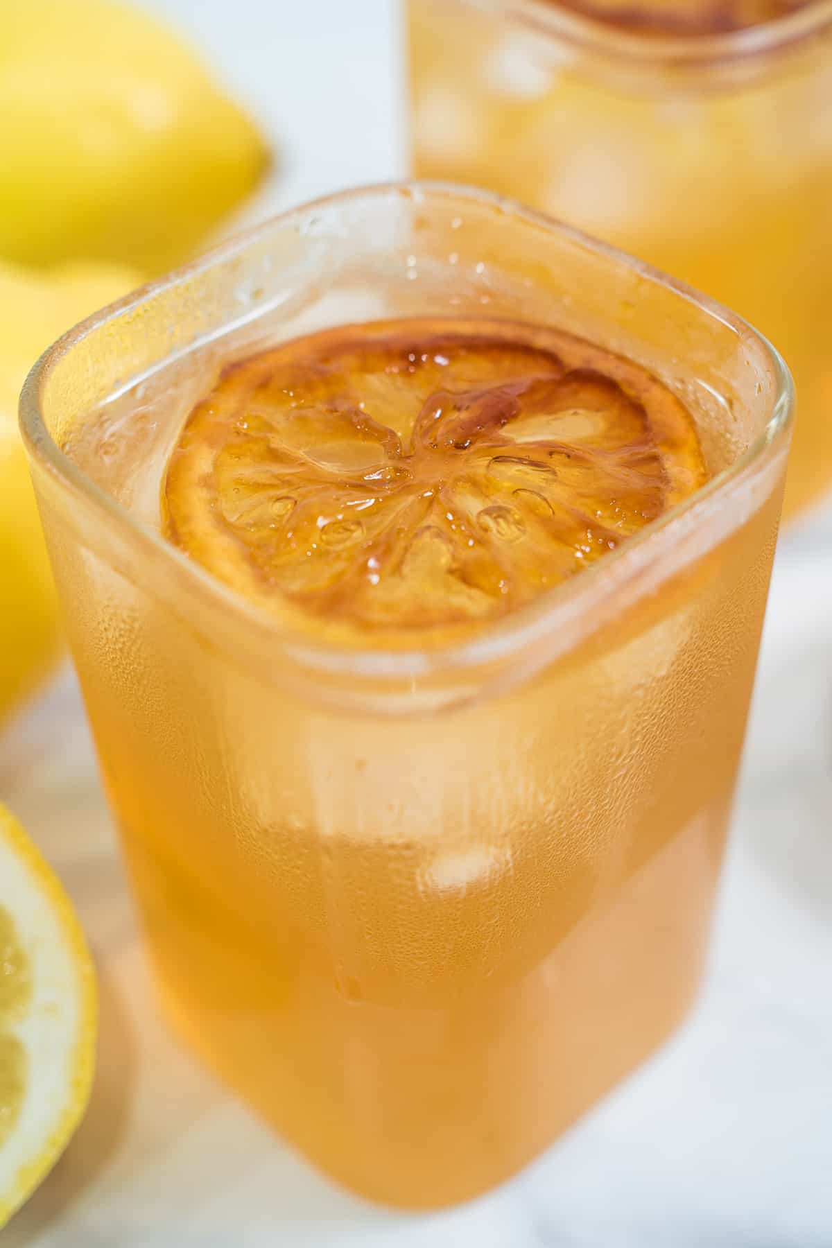 A glass of brown sugar lemonade with ice cubes