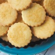 Scalloped cut out cookies in a blue plate